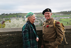 © Licensed to London News Pictures. 13/05/2016. Haworth, UK. A man and woman in 1940s costume enjoy the view during the annual 1940's weekend in Haworth, West Yorkshire.  Photo credit : Ian Hinchliffe/LNP