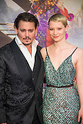 Johnny Depp and Mia Wasikowska - Alice Through the Looking Glass premiere - a Walt Disney American fantasy adventure film directed by James Bobin, written by Linda Woolverton and produced by Tim Burton. It is based on Through the Looking-Glass by Lewis Carroll and is the sequel to the 2010 film Alice in Wonderland. The film stars Johnny Depp, Anne Hathaway, Mia Wasikowska, Rhys Ifans, Helena Bonham Carter, and Sacha Baron Cohen and features the voices of Alan Rickman, Stephen Fry, Michael Sheen, and Timothy Spall.