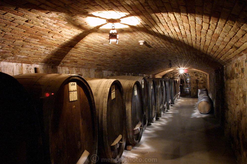 Wine barrels in the Sattui Winery wine cave in Napa Valley, California.
