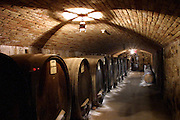 Wine barrels in the Sattui Winery wine cave in Napa Valley, California.