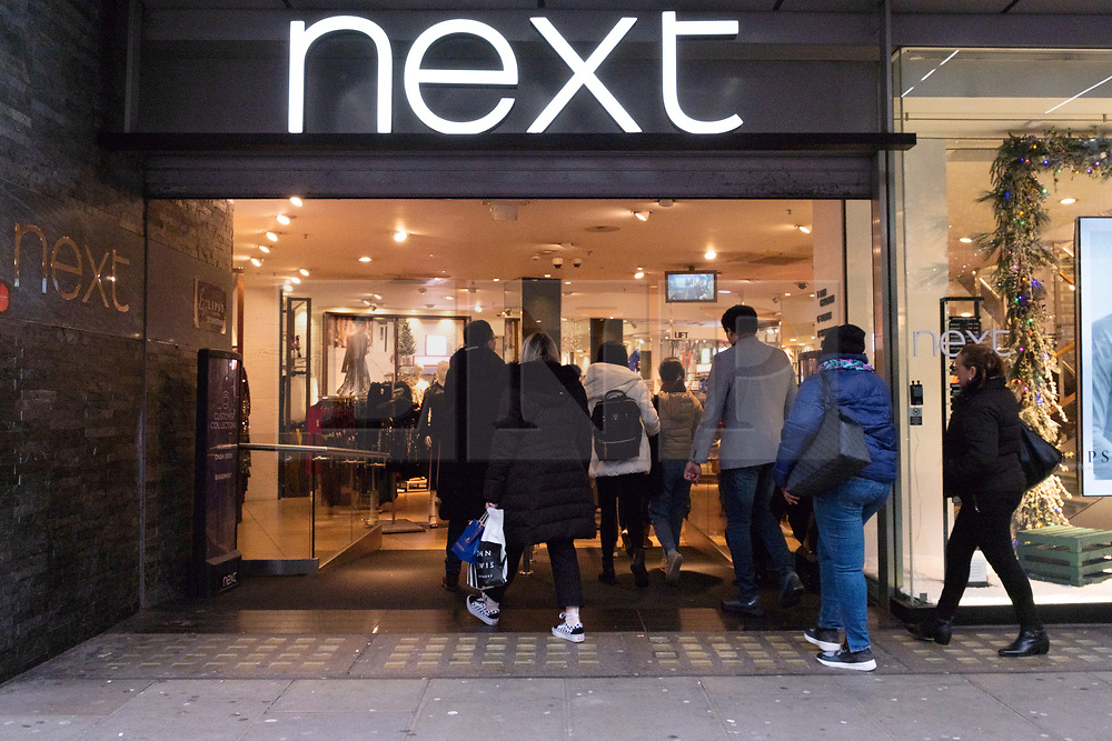 © Licensed to London News Pictures. 23/11/2018. London, UK. Shoppers enter a Next clothes store open in Oxford Street at the beginning of Black Friday sales. Photo credit: Ray Tang/LNP