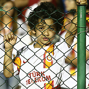 Galatasaray's supporter child behind the wire fence on the stadium during their Turkish Super Cup 2012 soccer derby match Galatasaray between Fenerbahce at the Kazim Karabekir stadium in Erzurum Turkey on Sunday, 12 August 2012. Photo by TURKPIX
