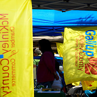 """082413  Adron Gardner/Independent<br /> <br /> Chamber of Commerce flags fly at businesses represented  for the """"Gallup Business Rocks,"""" business expo at the Gallup Cultural Center in Gallup Saturday."""