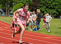 Bessie Margaret Lipman, Ciara Ricks and Ella Tryon compete in the 200 meter dash during the 5th grade track meet at Opechee Park on Wednesday.  (Karen Bobotas/for the Laconia Daily Sun)