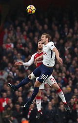 Tottenham Hotspur's Harry Kane (right) and Arsenal's Shkodran Mustafi battle for the ball during the Premier League match at the Emirates Stadium, London.