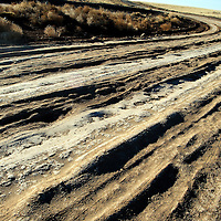 010813  Adron Gardner/Independent<br /> <br /> The surface of Navajo Route 6910 furrows from weathering near Leupp Wednesday.