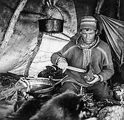 Sami man in his hut, Finland