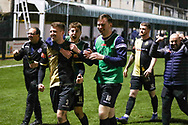 Marine players celebrate at the final whistle during the The FA Cup match between Marine and Havant & Waterlooville FC at Marine Travel Arena, Great Crosby, United Kingdom on 29 November 2020.