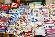 Display of tea towel textile souvenir products of butterflies and fish on sale, city of Evora, Alto Alentejo, Portugal, southern Europe