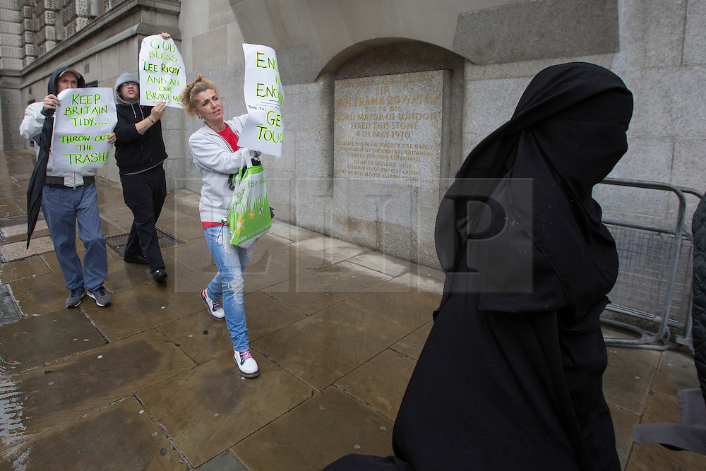© licensed to London News Pictures. London, UK 16/08/2013. Right wing protesters hold banners when Rebekah Dawson arriving to The Old Bailey Court in London on Friday, 16 August 2013. 21-year-old woman has been charged with terror offences over video clips about the murder of soldier Lee Rigby. Rebekah Dawson, of Hackney, east London, is accused of dissemination of terrorist publications and encouragement of terrorism. Photo credit: Tolga Akmen/LNP