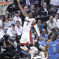 21 June 2012: Miami Heat shooting guard Dwyane Wade (3) goes for the layup on an alley hoop during the Miami Heat 121-106 victory over the Oklahoma City Thunder, in Game 5 of the 2012 NBA Finals, at the AmericanAirlinesArena, Miami, Florida, USA. The Miami Heat wins the series 4-1.