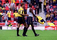 Arsenal captain Tony Adams consoles Patrick Vieira after he is sent off by referee Steve Dunn. Sunderland 1:0 Arsenal, 19/8/2000. Credit Colorsport / Stuart MacFarlane