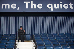 A West Bromwich Albion fan in the stands before the Premier League match at The Hawthorns, West Bromwich.
