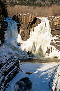 High Falls on the Pigeon River on a cold winter day; Grand Portage State Park, Grand Portage, Minnesota, USA.