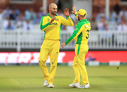 Australia's Nathan Lyon (left) celebrates the catch of New Zealand's James Neesham with team-mate during the ICC Cricket World Cup group stage match at Lord's, London.