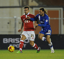 Bristol City's Marlon Pack is challenged by Gillingham's Bradley Dack - Photo mandatory by-line: Dougie Allward/JMP - Mobile: 07966 386802 - 29/01/2015 - SPORT - Football - Bristol - Ashton Gate - Bristol City v Gillingham - Johnstone Paint Trophy