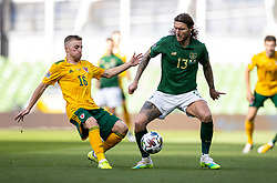 DUBLIN, REPUBLIC OF IRELAND - Sunday, October 11, 2020: Wales' Joseff Morrell (L) and Republic of Ireland's Jeff Hendrick during the UEFA Nations League Group Stage League B Group 4 match between Republic of Ireland and Wales at the Aviva Stadium. The game ended in a 0-0 draw. (Pic by David Rawcliffe/Propaganda)
