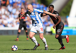 Huddersfield Town's Aaron Mooy (left) and Arsenal's Ainsley Maitland-Niles battle for the ball during the Premier League match at the John Smith's Stadium, Huddersfield.