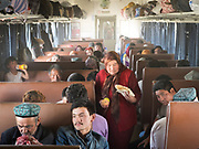 Life inside the train - mostly Muslim Uighur people  ride this train.