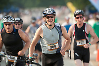 Competitors during the bike leg of the Timberman Sprint at Ellacoya State Park in Gilford, NH. (Karen Bobotas Photographer)