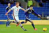 Cardiff City's Tom Lawrence (r) goes past M K Dons Dean Lewington. Skybet football league championship match, Cardiff city v MK Dons at the Cardiff city stadium in Cardiff, South Wales on Saturday 6th February 2016.<br /> pic by Carl Robertson, Andrew Orchard sports photography.