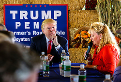 October 24, 2016 - Florida, U.S. - Donald Trump listens as he is introduced by Marie Bedner, co-owner of Bedner Farms, at a farmer's roundtable event Monday, October 24, 2016. (Credit Image: © Lannis Waters/The Palm Beach Post via ZUMA Wire)