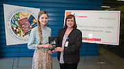 Texas Connections Academy eighth grader Maggie Martin, left, receives a Kindle Fire from Houston ISD Library Services manager Elizabeth Philippi, right, for her winning artwork to promote the Houston ISD Summer Reading Program, April 25, 2014.