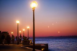 THEMENBILD - URLAUB IN KROATIEN, Touristen spazieren in der Abendstimmung an der Promenade, aufgenommen am 03.07.2014 in Porec, Kroatien // Tourists walk in the evening atmosphere on the promenade at Porec, Croatia on 2014/07/03. EXPA Pictures © 2014, PhotoCredit: EXPA/ JFK