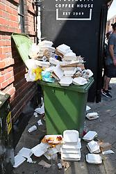 Overflowing rubbish bin, Norwich Lanes Summer Fayre, July 2019, UK