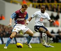 Photo: Ed Godden.<br /> Tottenham Hotspur v Aston Villa. The Barclays Premiership. 26/12/2006. Spurs' Didier Zokora (R), tries to block Steven Davis.