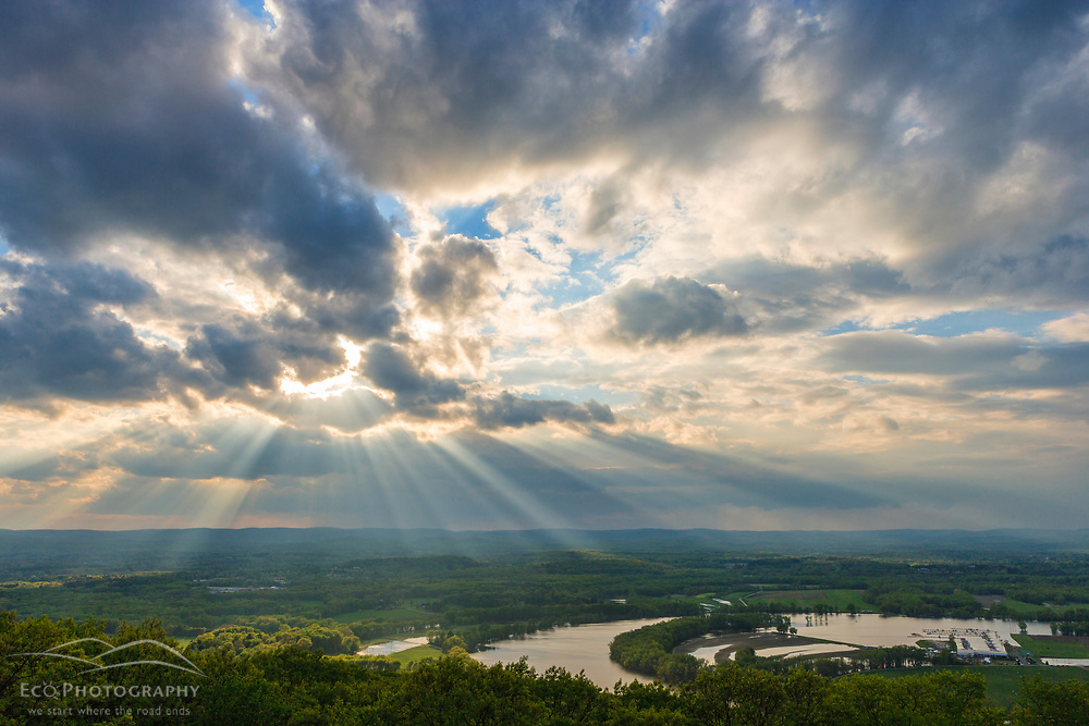 God Rays and clouds above the Connecticut River Oxbow in Northampton Massachusetts.  View from Mount Tom. New England Trail