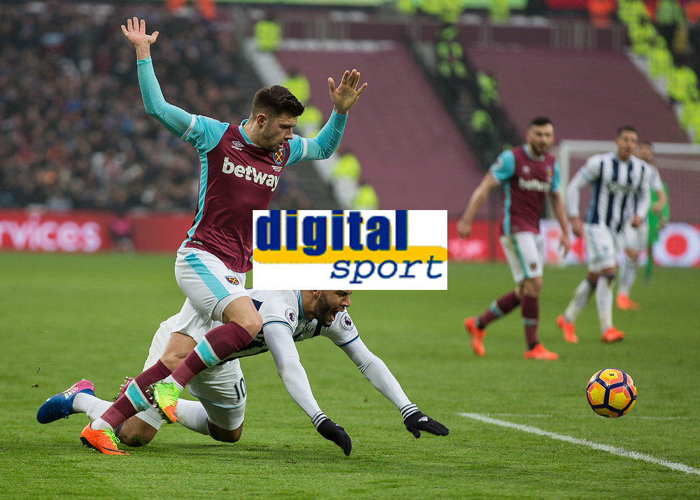 Football - 2016 / 2017 Premier League - West Ham United vs. West Bromwich Albion<br /> <br /> Matt Phillips of West Bromwich Albion falls down as Aaron Cresswell of West Ham holds his hands in the air at the London Stadium.<br /> <br /> COLORSPORT/DANIEL BEARHAM