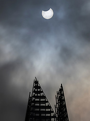 © Licensed to London News Pictures. 10/06/2021. London, UK. The moon passes in front of the sun during a partial eclipse viewed over The Shard in central London. Photo credit: Peter Macdiarmid/LNP