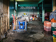 31 DECEMBER 2015 - BANGKOK, THAILAND: Street food carts stored in an empty store front in Bang Chak Market. The market is supposed to close permanently on Dec 31, 2015. The Bang Chak Market serves the community around Sois 91-97 on Sukhumvit Road in the Bangkok suburbs. About half of the market has been torn down. Bangkok city authorities put up notices in late November that the market would be closed by January 1, 2016 and redevelopment would start shortly after that. Market vendors said condominiums are being built on the land.          PHOTO BY JACK KURTZ