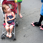 A young girl in a stroller between a man dressed as Uncle Sam and the other as an eagle during Carolina Fest in 2012.