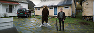Steinar Ovrebo withe the bear he shot in Siberia  the year before, in the back Bjorn Kaaks
