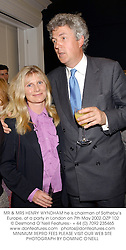 MR & MRS HENRY WYNDHAM he is chairman of Sotheby's Europe, at a party in London on 7th May 2002.OZP 102