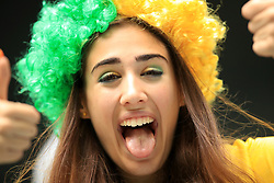 A Brazil fans shows her support ahead of the match