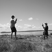 A hillside overlooking the sprawling course was the scene of a camera duel between friends.
