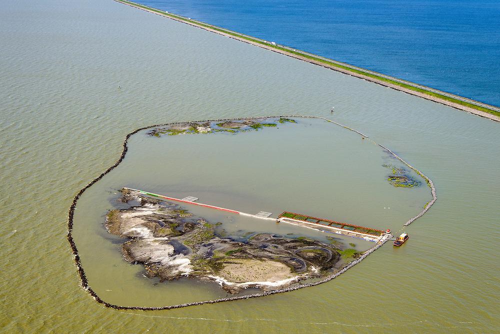 Nederland, Flevoland, Lelystad, 07-05-2015. Proefmoeras naast de Houtribdijk, tussen Trintelhaven en Lelystad. Het moeras is aangelegd in het kader van het ontwikkelen van de Marker Wadden, ecologisch project gericht op de verbetering van de waterkwaliteit van het Markermeer-IJmeer (het meer bevat momentel te veel slib).<br /> Trial 'swamp', has been created to monitor the development of the so-called Marker Shallows, an ecological project aimed at improving the water quality of the inner sea.<br /> luchtfoto (toeslag op standard tarieven);<br /> aerial photo (additional fee required);<br /> copyright foto/photo Siebe Swart