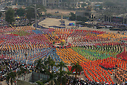 JINGHONG, CHINA - APRIL 15: (CHINA OUT) <br /> <br /> People Celebrate The Songkran Festival In Yunnan<br /> <br />  15,080 people dance with paper umbrellas to set a new Guinness World Record during a Songkran Festival on April 14, 2014 in Jinghong, Yunnan Province of China. Songkran Festival, which falls on April 15 this year, is an annual water-splashing event in celebration of the New Year in the Dai ethnic people\'s calendar. <br /> ©Exclusivepix