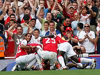 Photo: Steve Bond.<br />Arsenal v Derby County. The FA Barclays Premiership. 22/09/2007. Cesc Fabrigas (buried) celebrates