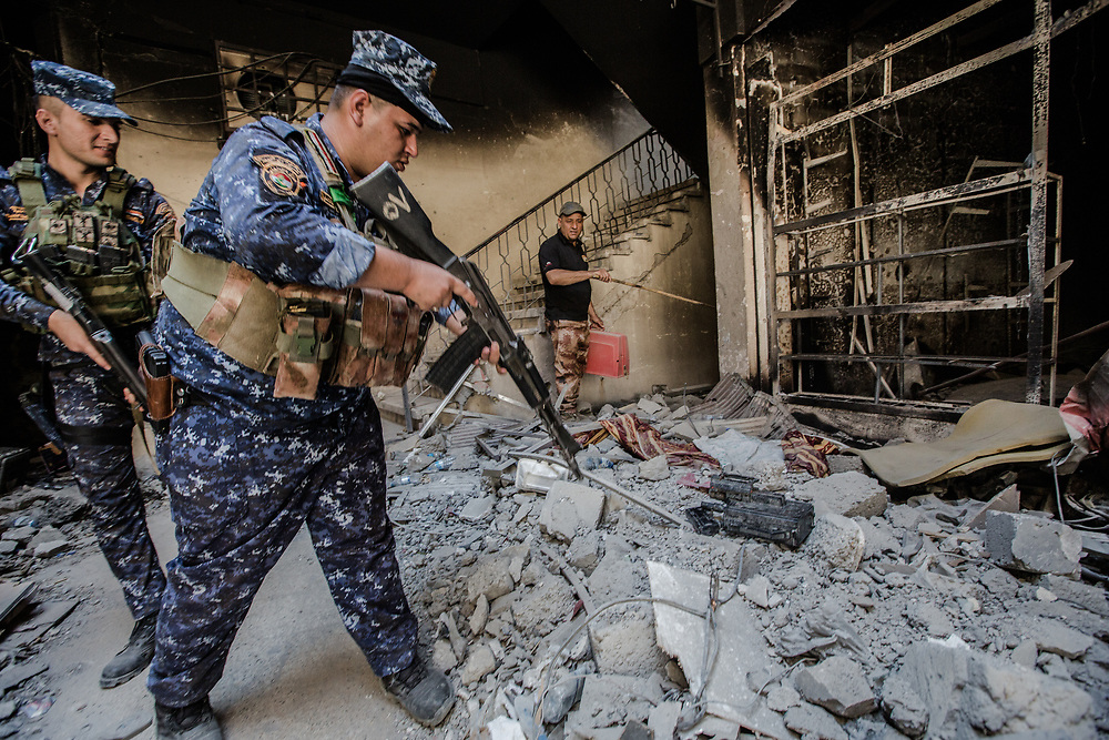 Iraqi Federal Police officers search for mines and booby traps in the old city after Mosul was liberated. One of the officers who is in charge of clearing mines said it's going to take at leat 15 days to clear the area.