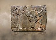 Photo of Hittite monumental relief sculpted orthostat stone panel of Procession. Basalt, Karkamıs, (Kargamıs), Carchemish (Karkemish), 900 - 700 B.C. Goddess Kubaba. Anatolian Civilisations Museum, Ankara, Turkey.<br /> <br /> Procession for. There are four figures on the other face of the orthostat. The leftmost figure plays a pipe, while the other three figures play the drums. All of the figures have long skirts and same body heights.  <br /> <br /> Against a brown art background. .<br />  <br /> If you prefer to buy from our ALAMY STOCK LIBRARY page at https://www.alamy.com/portfolio/paul-williams-funkystock/hittite-art-antiquities.html  - Type  Karkamıs in LOWER SEARCH WITHIN GALLERY box. Refine search by adding background colour, place, museum etc.<br /> <br /> Visit our HITTITE PHOTO COLLECTIONS for more photos to download or buy as wall art prints https://funkystock.photoshelter.com/gallery-collection/The-Hittites-Art-Artefacts-Antiquities-Historic-Sites-Pictures-Images-of/C0000NUBSMhSc3Oo
