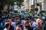 """Protestors clash with Police as they attempt to implement COVID19 Law against thousands of those who gathered in London's Trafalgar Square across the UK on Saturday, Sept 19, 2020 - afternoon to protest against coronavirus restrictions and reject mass vaccinations. The event, which began at noon, drew a broad coalition including coronavirus sceptics, 5G conspiracy theorists and so-called """"anti-vaxxers"""". Speakers at the event accused the government of attempting to curtail civil liberties. (VXP Photo/ Erica Dezonne)"""
