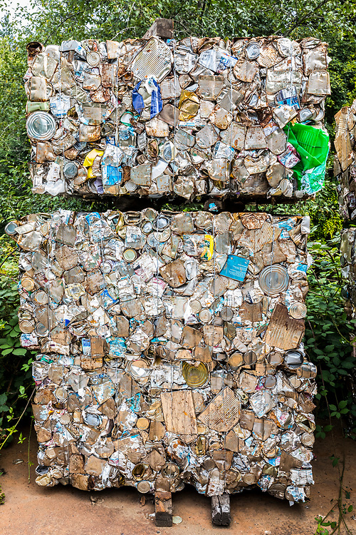 Steel cans smashed into cubes for recycling.