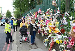 Flowers and tributes left at Woolwich Barracks for Drummer Lee Rigby who was murdered near the barracks, Woolwich Barracks, Woolwich, London, Great Britain. On the afternoon of 22 May 2013, Lee Rigby, a British Army soldier in the Royal Regiment of Fusiliers, was killed by two attackers near the Royal Artillery Barracks in Woolwich in southeast London, UK, 25th May 2013. Photo by Elliott Franks / i-Images.