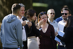 © Licensed to London News Pictures. 11/09/2021. London, UK. Families attend a service at the September 11 Memorial at Grosvenor Square in London on the 20th anniversary of the 9/11 terrorist attack. The attacks, which killed a total of 2,977 people - 67 of them British - saw passenger jets seized by suicide attackers, flown into the Twin Towers of the World Trade Center in New York and the The Pentagon building in Washington. Photo credit: Peter Macdiarmid/LNP
