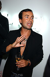 Fashion designer JULIEN MACDONALD at the launch of 'Blow Lips' a new lipstick by Isabella Blow and MAC Makeup held at the the Blow de la Barra Gallery, 35 Heddon Street, London on 7th September 2005.<br />
