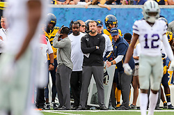 Sep 22, 2018; Morgantown, WV, USA; West Virginia Mountaineers offensive coordinator Jake Spavital watches a play from the sidelines during the first quarter against the Kansas State Wildcats at Mountaineer Field at Milan Puskar Stadium. Mandatory Credit: Ben Queen-USA TODAY Sports
